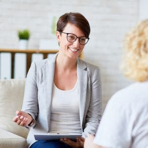 speech therapist working with patient on expressive aphasia treatment