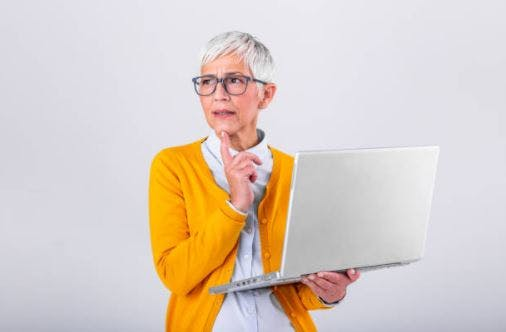 brain injury patient holding computer and looking confused