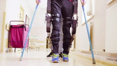 individual with complete paraplegia using exoskeleton to walk again