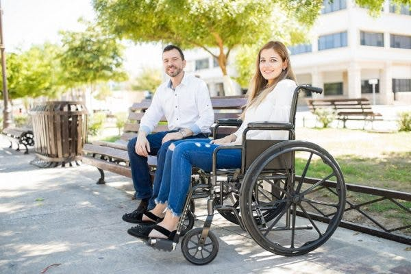 woman with incomplete quadriplegia in a wheelchair with significant other