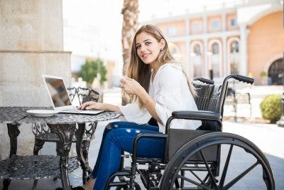woman in wheelchair at cafe