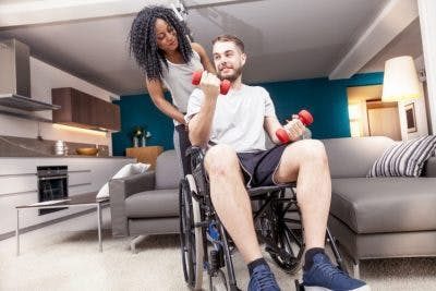 individual with incomplete quadriplegia participating in physical therapy to improve upper body functions