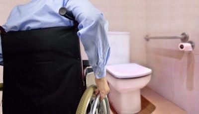man in wheelchair regaining bladder control after spinal cord injury