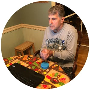 Ron, a stroke survivor, using FitMi home therapy to recover his paralyzed arm