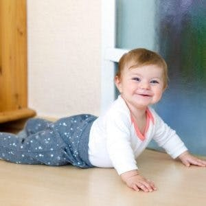 child with cerebral palsy commando crawling
