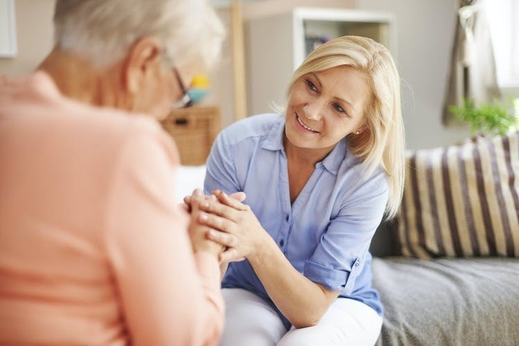 caregiver comforting patient with mood swings after stroke