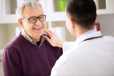 doctor helping patient manage aphasia