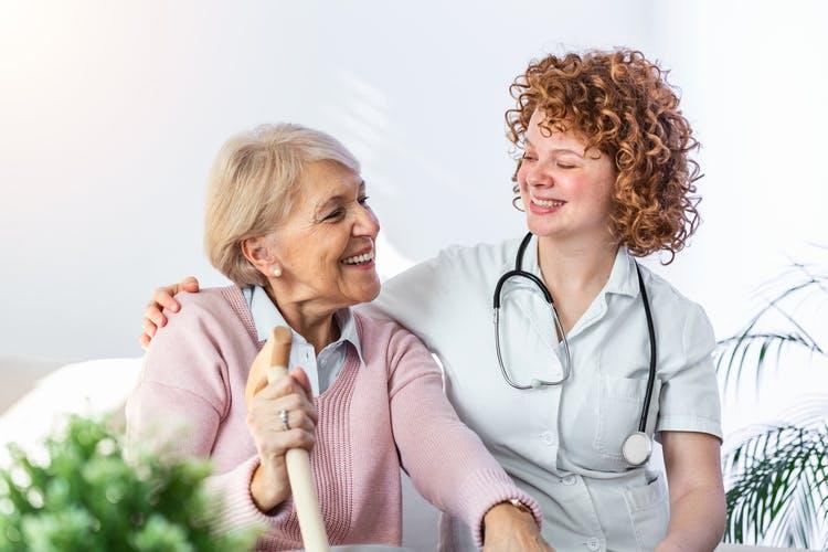 nurse smiling at patient with primary progressive aphasia