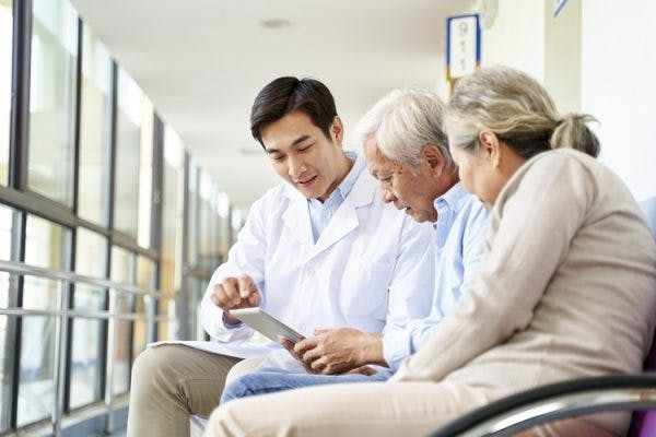 doctor explaining conduction aphasia to patient and his wife