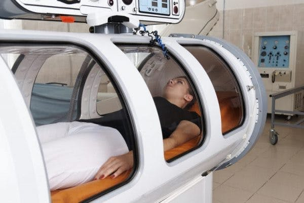 woman trying hyperbaric oxygen therapy for spinal cord injury