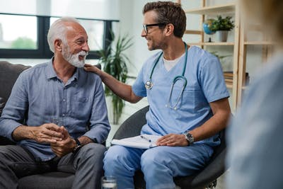 doctor and patient smiling and talking in office