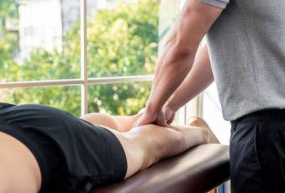 spinal cord injury patient getting massage to naturally promote circulation