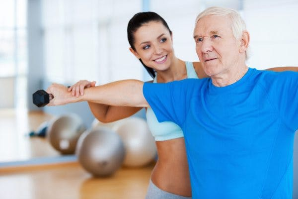physical therapist helping stroke patient regain muscle function
