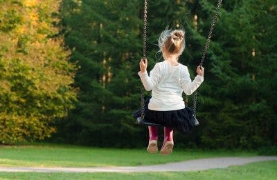 young girl with cerebral palsy swinging