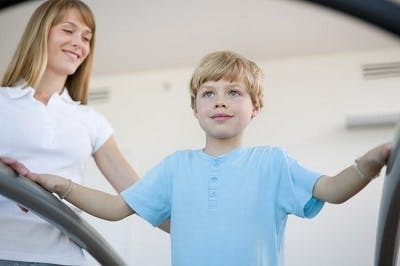 kid with cerebral palsy at physical therapy to improve walking