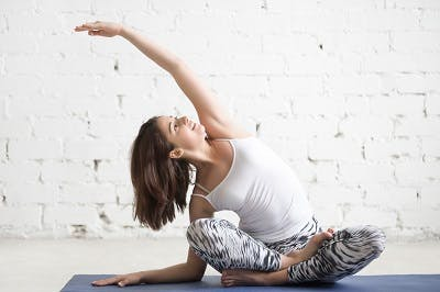woman with tbi practicing yoga