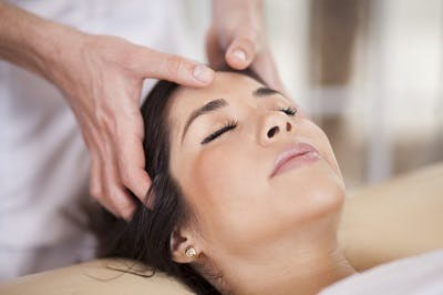 woman with traumatic brain injury participating in craniosacral therapy