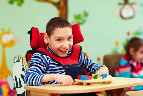 young boy with hydrocephalus and cerebral palsy