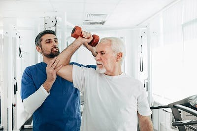 stroke survivor participating in physical therapy for pain management
