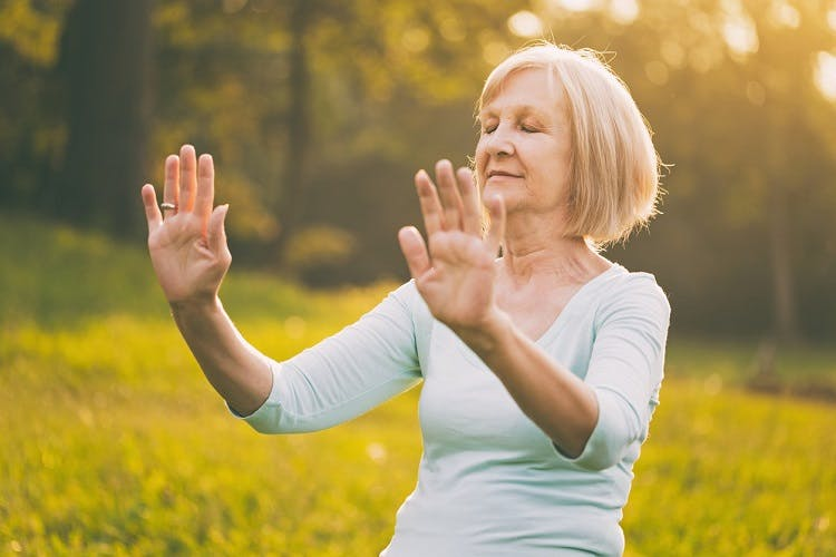 stroke survivor practicing tai chi to promote recovery