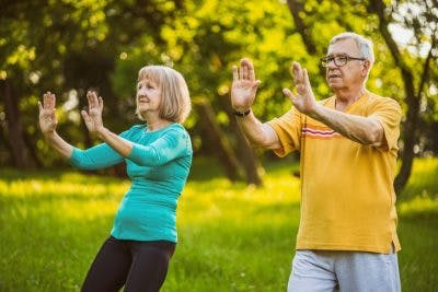 elderly couple practicing tai chi to improve balance after stroke