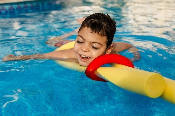 child with cerebral plasy participating in aquatic therapy to improve mobility