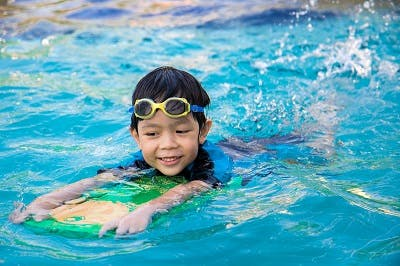 child with cerebral palsy practicing aquatic therapy exercises