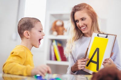 Speech therapist teaches boy with cerebral palsy to say the letter A