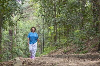 woman exercising to lower high cholesterol and reduce risk of stroke