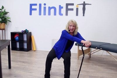 therapist demonstrating stretches for stroke patients