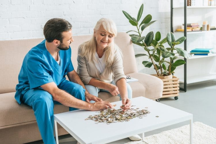 woman participating in occupational therapy for brain injury rehabilitation