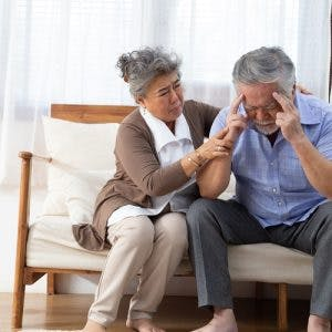 woman consoling husband with headache and worried about what a stroke feels like