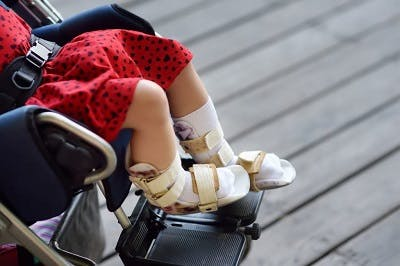 child wearing ankle foot orthotics