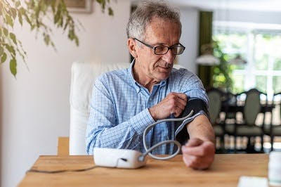 man carefully managing hypertension because he know it can cause a stroke