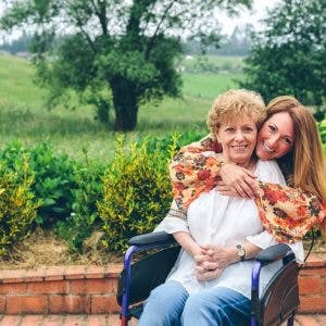 woman overcoming psychological effects of spinal cord injury with support of daughter