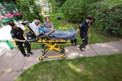 woman on stretcher being taken to emergency room for stroke symptoms