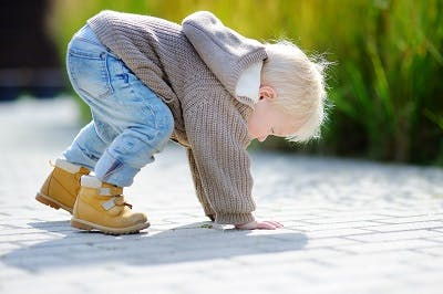 toddler with ataxic cerebral palsy frequently falling due to impaired balance and coordination