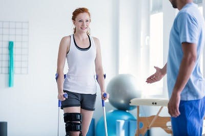 spinal cord injury patient participating in physical therapy to promote neuroplasticity