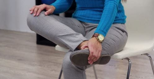 therapist with ankle in contracted position for foot drop walking exercise