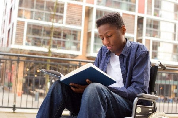 teen reading about the cognitive effects of spinal cord injury