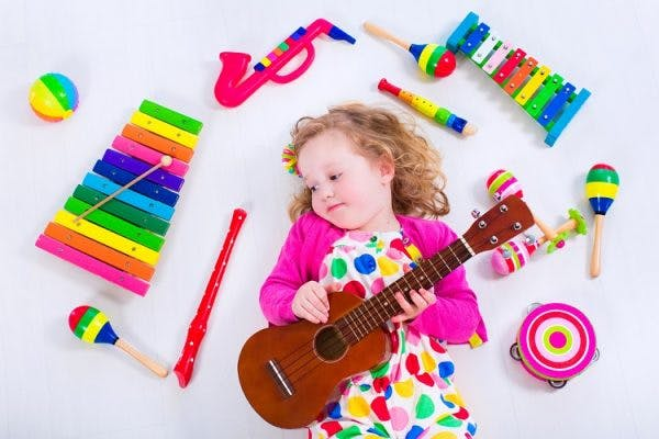 young girl with cerebral palsy participating in music therapy