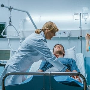 doctor assessing patient for abnormal posturing after severe brain injury