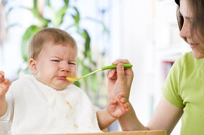 baby with cerebral palsy struggling to eat because of facial motor impairments
