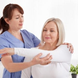 Doctor and patient in rehabilitation clinic after getting intrathecal baclofen pump to manage spasticity