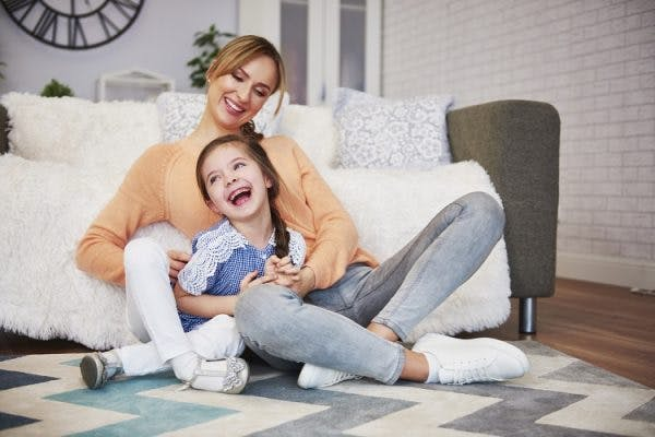 young girl with mild cerebral palsy playing with mother