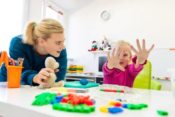 young child with cerebral palsy practicing occupational therapy activities