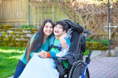 boy with severe cerebral palsy and his mom