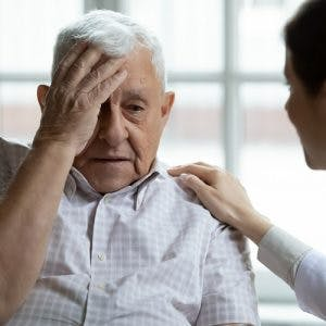 doctor helping patient with agnosia