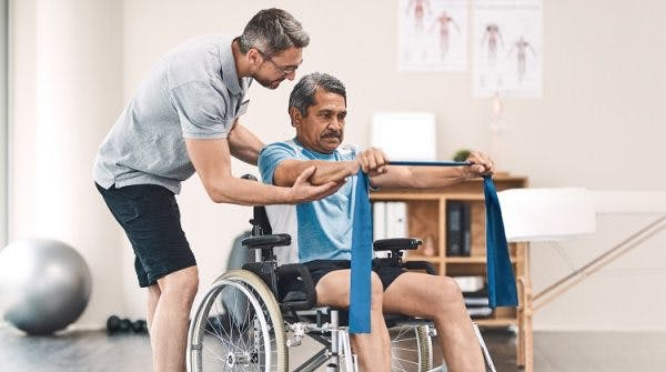 individual with incomplete spinal cord injury working on therapy